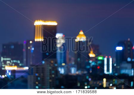 Night blurred lights office building twilight sky abstract background