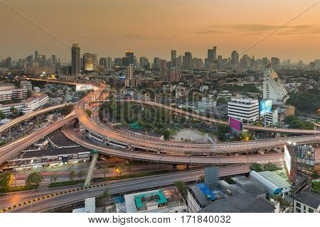 Aerial view Bangkok city downtown background and highway intersection during sunset Thailand