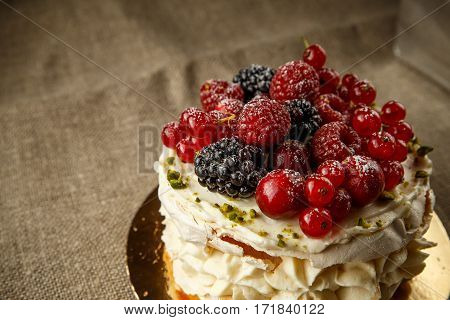 Pavlova, a home made cake from layers of meringue, whipped cream, and fresh berries.
