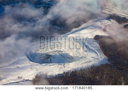 View from above of granite quarry in Ural mountains in winter in vicinity of Berdyaush, Southern Ural, Russia