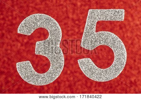 Number thirty-five silver color over a red background. Anniversary. Horizontal