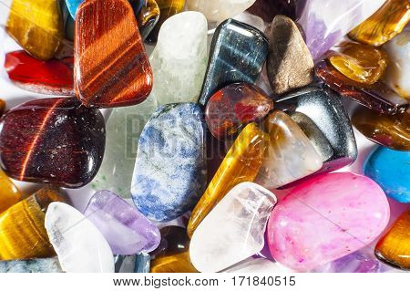 Full frame of rounded gemstones as background