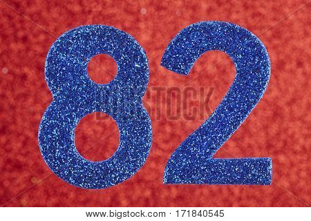 Number eighty-two blue color over a red background. Anniversary. Horizontal