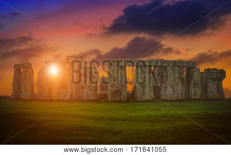 Landscapes image of sunset over Stonehenge an ancient prehistoric stone monument Wiltshire UK.