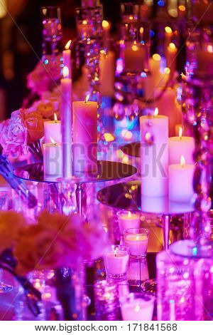 Table Set With Candles For A Festive Event, Party Or Wedding Reception, In Purple Light
