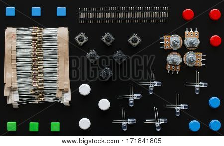 Sime electronic components and different colours buttons and connectors