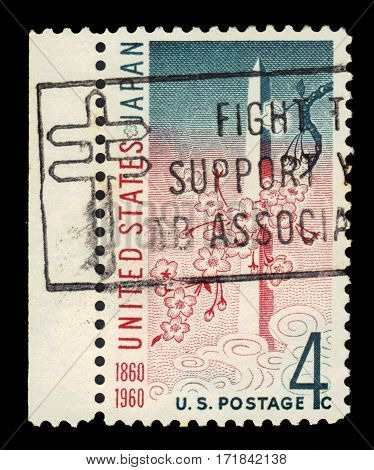 USA - circa 1960: A stamp printed in United States of America shows Washington Monument and cherry ( sakura ) blossoms, USA-Japan treaty issue, circa 1960
