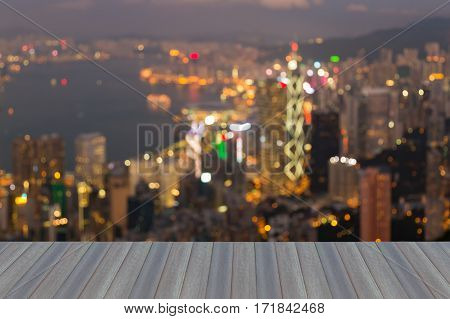 Opeing wooden floor abstract blurred light Hong Kong city night view