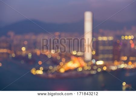 Blurred bokeh light Hong Kong business area aerial view over Victoria Bay