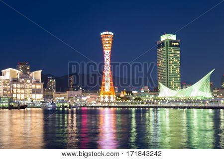 Abstract blurred bokeh light Kobe port tower with reflection and twilight sky background