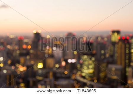 Blurred bokeh lights city of Osaka central business downtown abstract background