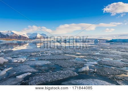 Iceland winter lake with blue sky natural landscape background in winter season
