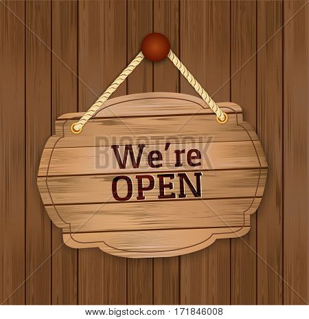 Vintage vector retro-styled wooden door we are open hanging sign on wood background.