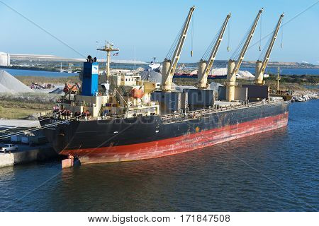 Tampa Bay Florida - February 11th 2017: Dredging tanker docked for repairs Tampa Bay Florida - February 11th 2017