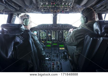 Military Carrier Airplane Cockpit And Pilots