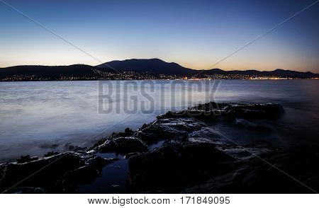 View from Tranmere on the River Derwent with illuminated Hobart, Tasmania with Mount Wellington in background