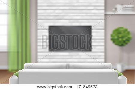 Sofa in the foreground against on unfocused living room interior background.