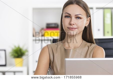 Portrait Of Positive Businesswoman In Office