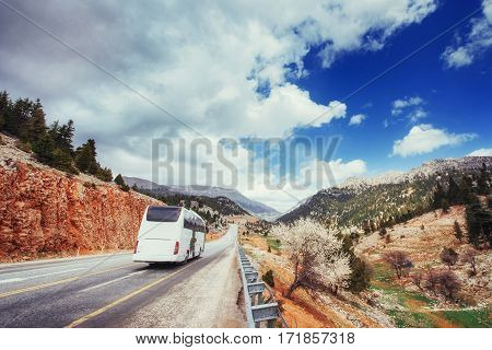 beautiful scenic highway in mountains. Car rides on asphalt surfaces