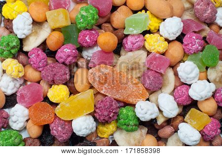 Dried fruits and nuts in sugar scattered even layer