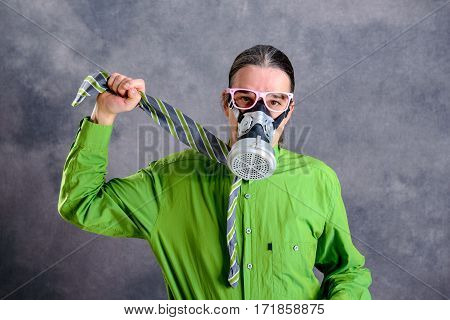 Young Business Man In Green Shirt With Gas Mask