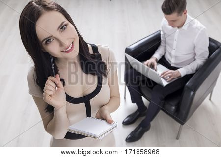 Woman With Notebook, Man With Laptop
