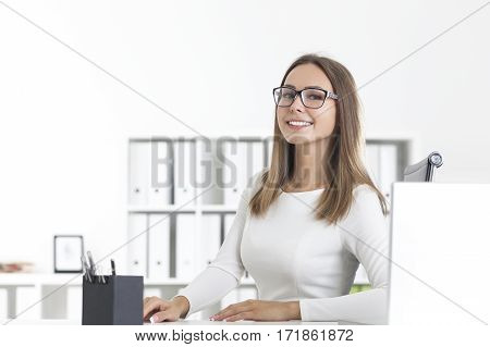Front View Of Smiling Businesswoman In Glasses
