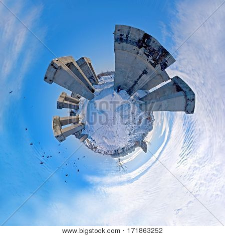 Circular panorama of megalithic structures in the snowy expanse of desert
