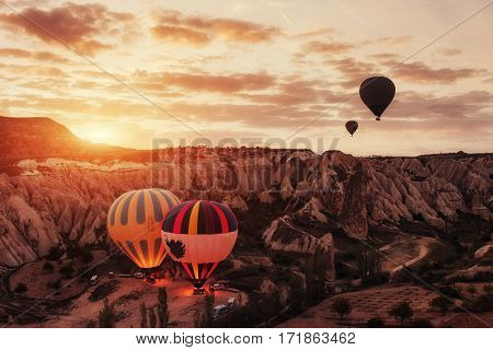 Amazing sunset over Cappadocia. Beautiful color balloons Turkey