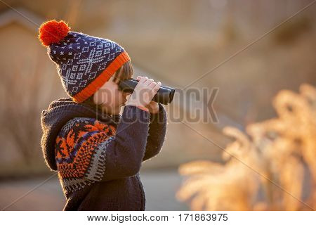 Cute Little Child, Boy, Exploring Nature With Binoculars
