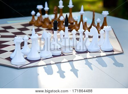 Chess Game. Chess Pieces On The Hexagonal Chess Board.