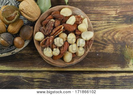 Roasted salted nuts mix snack from macadamia walnotes and almonds and unshelled nuts