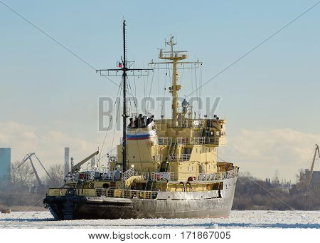 The powerful icebreaker breaks the ice freeing the path for ships.