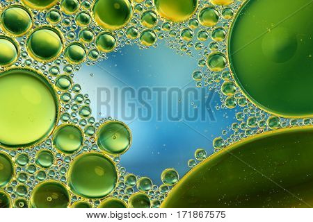 Oil in water abstract circles on a colorful blue background