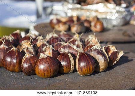 Delicious roasting chestnuts on pan for sale at streets of Sofia Bulgaria