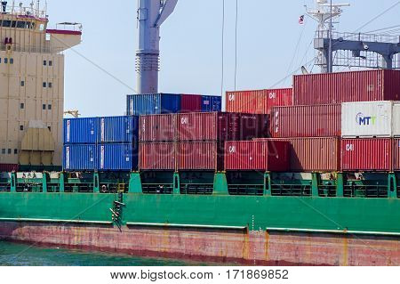Labuan,Malaysia-Feb 8,2017:Shipping containers waiting to be loaded on a cargo ship in Labuan port,Malaysia on 8th Feb 2017.
