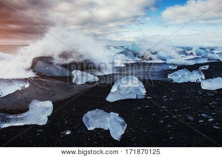 Jokulsarlon glacier lagoon, fantastic sunset on the black beach, Iceland.