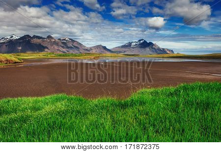 Gentle slopes of snow-capped mountains and glaciers. Wonderful Iceland in the spring.