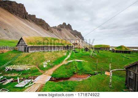 Traditional Viking village. Wooden houses near the mountain first settlements in Iceland.