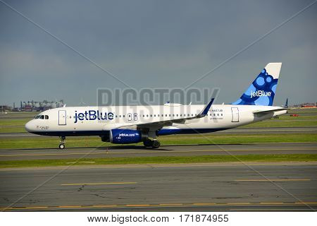 BOSTON - MAY. 6, 2015: Jetblue Airways Airbus 320 taxiing at Boston Logan International Airport, Boston, Massachusetts, USA.