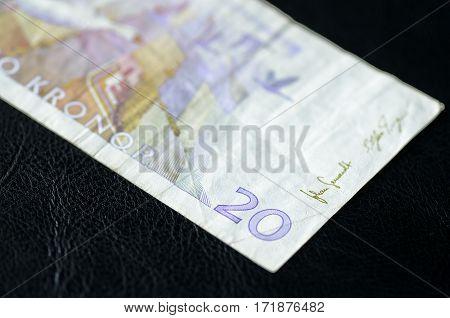 Obsolete Banknote in twenty Swedish kronor on a dark background poster