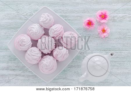 lovely pastel rose meringues, zephyrs, marshmallows and a coffee pot on the vintage table