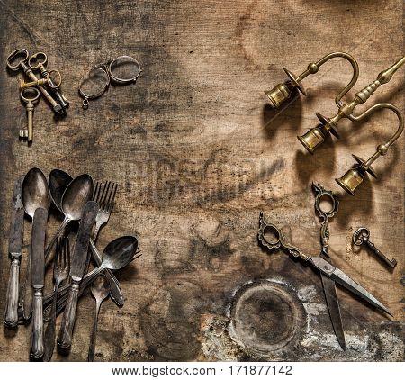 Vintage cutlery candlestick scissors keys. Nostalgic still life flat lay