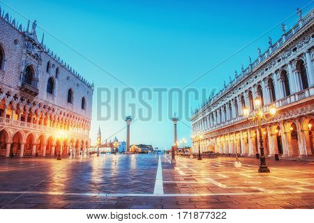 St Mark's Square and Campanile bell tower in Venice at sunrise. Italy. Many tourists visiting the beauty of the city throughout the year. Europe