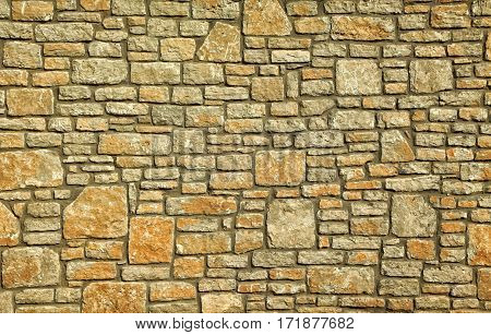 Old stone wall with an irregular pattern. Stone wall full frame background.