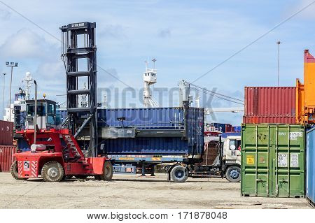 Labuan,Malaysia-July,21,2016:Mobile container handler in action at a container terminal in the Port of Labuan Island,Malaysia .