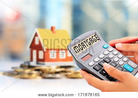 Loan calculator and house. Real estate investment.