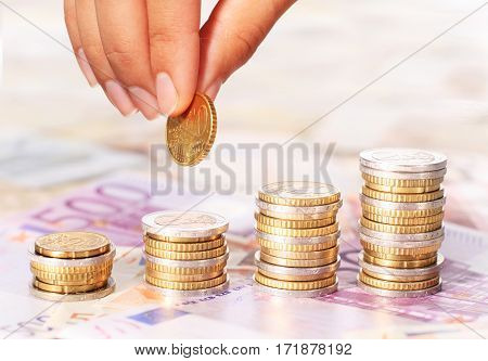 Euro coins. Stacks of coins and paper money.
