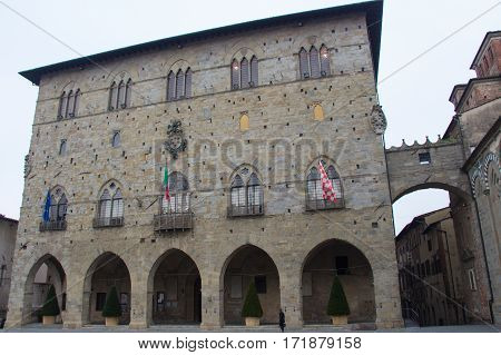 Italy Pistoia - November 27 2016: the view of Palazzo del Comune City Hall Municipial museum of Pistoia on November 27 2016 in Pistoia Tuscany Italy.