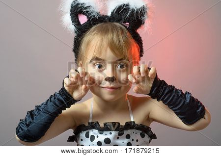 Portrait Of A Little Girl With Cat Make-up On A Gray Background.